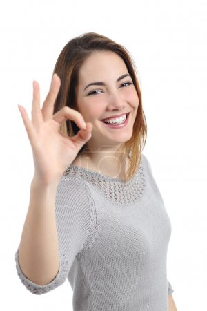 Photo for Happy woman gesturing ok isolated on a white background - Royalty Free Image