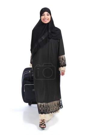 Full body of an arab saudi woman traveler walking