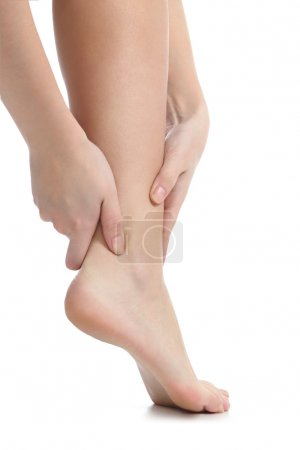 Photo for Pain concept with a woman hands catching ankle isolated on a white background - Royalty Free Image
