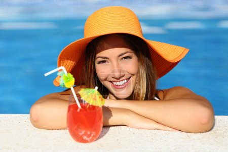Beauty woman with perfect smile enjoying in a swimming pool on vacations