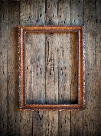Old Vintage Frame on the wooden wall