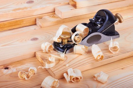 Photo for Small Block Plane and Wood on work bench with shavings - Royalty Free Image