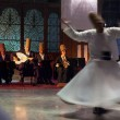Whirling dervishes and musicians perform to visito...