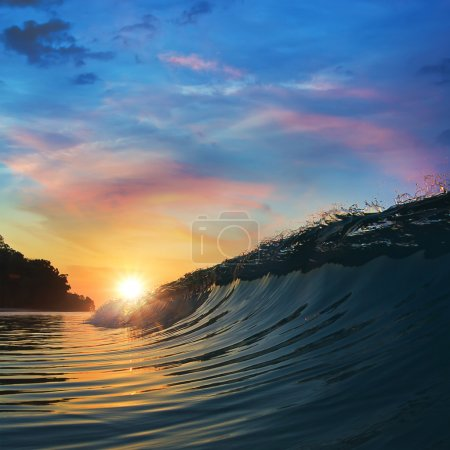 Open water landscape rough colored ocean wave breaking at sunset time