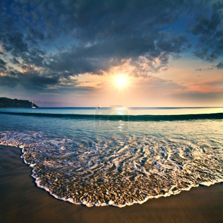 Summer sea design template. Beautiful sunset on tropical beach with shorebreak and sunlight on horizon