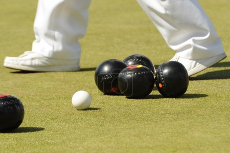 Photo for Photograph of lawn bowls with bowlers feet walking past - Royalty Free Image