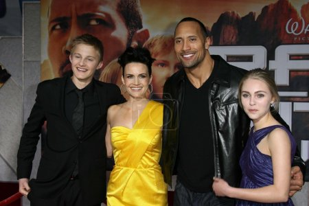 Alexander Ludwig and Carla Gugino with Dwayne Johnson and AnnaSophia Robb at the Los Angeles Premiere of Race To Witch Mountain. El Capitan Theatre, Hollywood, CA. 03-11-09