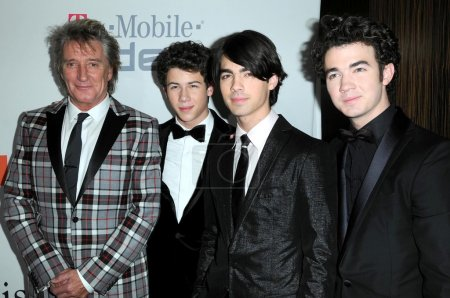 Photo for Rod Stewart and Nick Jonas with Joe Jonas and Kevin Jonas at the Salute To Icons Clive Davis Pre-Grammy Gala. Beverly Hilton Hotel, Beverly Hills, CA 02-07-09 - Royalty Free Image