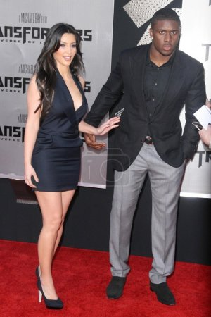 Kimberly Kardashian and Reggie Bush
