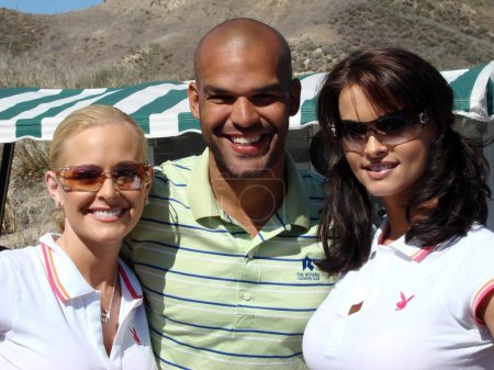 Katie Lohmann with Amaury Nolasco and Karen McDougal at the 7th Annual Playboy Golf Scramble Championship Finals. Lost Canyons Golf Club, Simi Valley, CA. 03-30-07