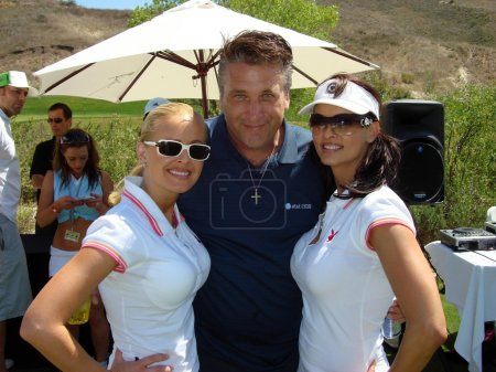 Katie Lohmann with Daniel Baldwin and Karen McDougal at the 7th Annual Playboy Golf Scramble Championship Finals. Lost Canyons Golf Club, Simi Valley, CA. 03-30-07