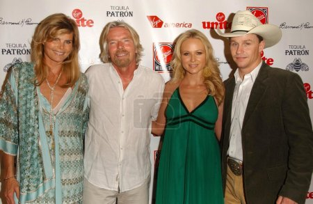 Photo for Mariel Hemingway and Richard Branson with Jewel and Ty Murray at Rock The Kasbah presented by Virgin Unite. Roosevelt Hotel, Hollywood, CA. 07-02-07 - Royalty Free Image