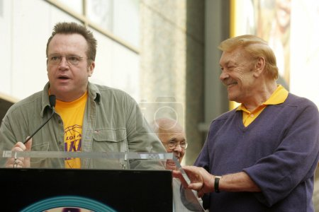 Tom Arnold and Jerry Buss