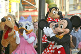 Pluto, Daisy Duck, Minnie Mouse, Mickey Mouse and Goofy help Donald Duck celebrate