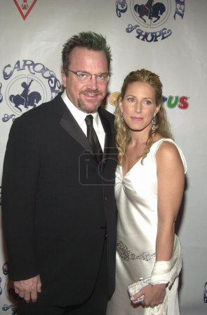 Tom Arnold and date