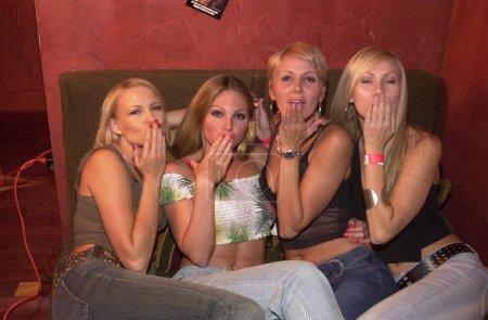 Photo for PERFECT 10 Models Irina, Jenny Leone, Jennifer Snow and Brandy Ritchey at the PERFECT 10 Magazine party, held at The Garden of Eden Nightclub, Hollywood, CA 07-27-02 - Royalty Free Image