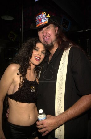 """Julie Strain with seven foot tall """"Big Mike"""""""