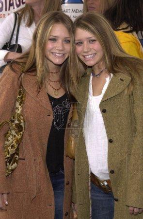Photo for Mary-Kate and Ashley Olsen at the 2001 Bogart Backstage concert gala fundraiser for the Neil Bogart Memorial Fund, Barker Hanger, Santa Monica, 11-11-01 - Royalty Free Image