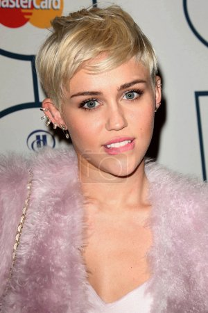 Photo for Miley Cyrus at the 56th Annual GRAMMY Awards Pre-GRAMMY Gala, Beverly Hilton, Beverly Hills, CA 01-25-14 - Royalty Free Image