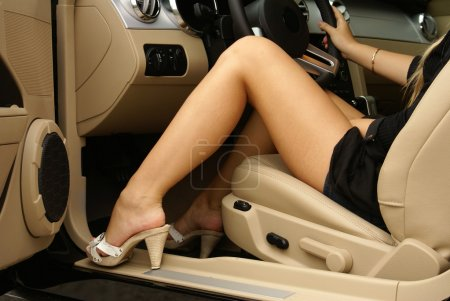 Photo for Sexy legs in a car - Royalty Free Image