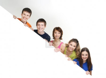 Photo for Group of teenagers with a giant, blank, white billboard - Royalty Free Image