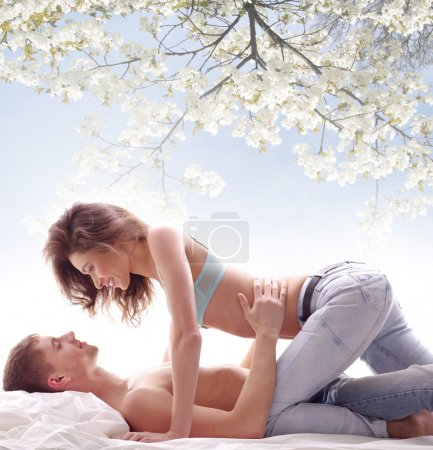 Young loving couple under the tree