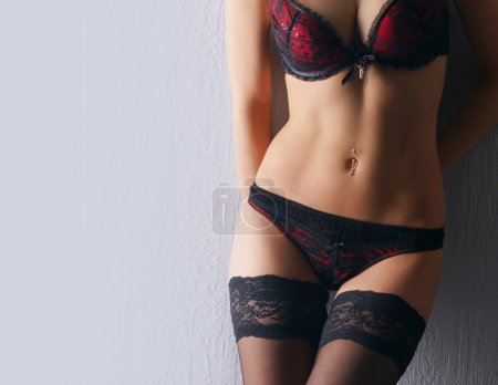 Young sexy woman in erotic lingerie