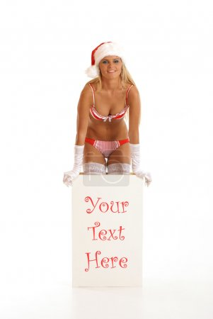 Photo for Young sexy Santa gets out of a box isolated on white - Royalty Free Image