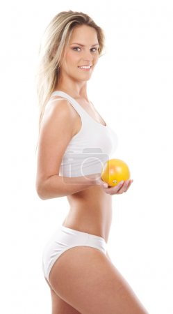 Young sexy girl with exotic fruit isolated on white