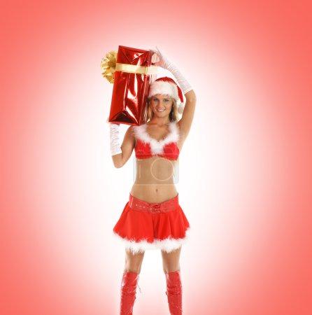 Photo pour Jeune Père Noël sexy isolé sur rouge - image libre de droit