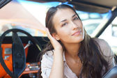 Portrait of young attractive woman in the car