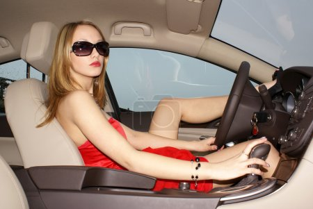 Sexy woman in a car