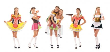 Photo pour Jeunes et belles filles bavaroises isolées sur fond blanc - image libre de droit