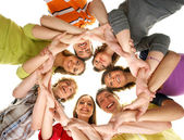 Group of smiling teenagers staying together and looking at camera