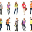 Group of smiling teenagers staying together and lo...