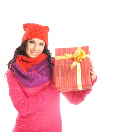 Young and beautiful woman holding a nice Christmas present