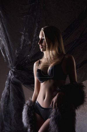 Young sexy woman in lingerie over luxury background