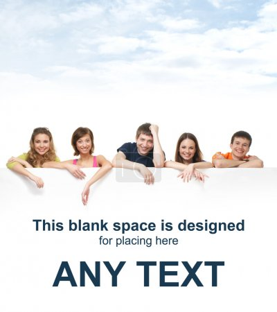 Photo for Group of teenagers with a giant, blank, white billboard over the sky background - Royalty Free Image