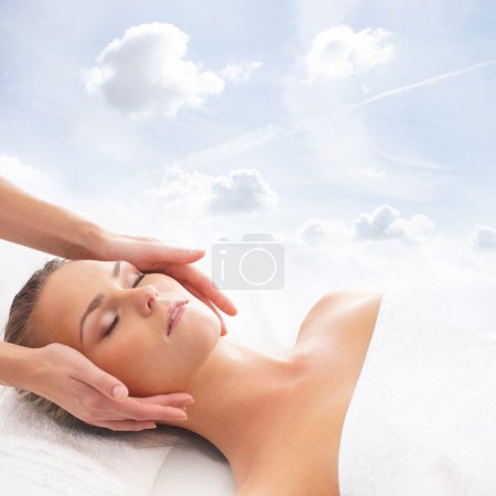 Young attractive woman getting spa treatment over white backgrou