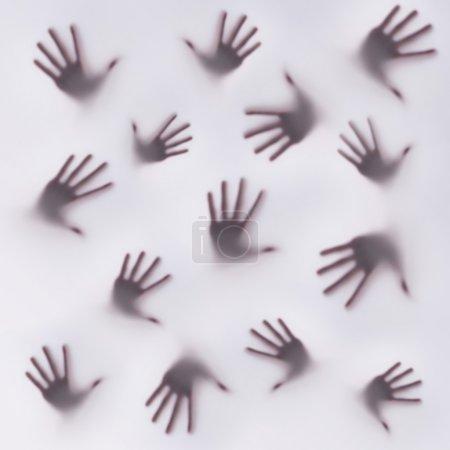 Photo pour Silhouette effrayante de nombreuses mains différentes - image libre de droit