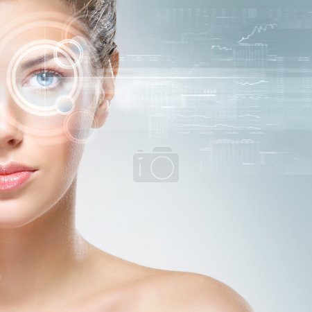 Photo for Young and attractive woman from future with the laser hologram on her eyes (collage about ophtalmology and eye scanning technology) - Royalty Free Image