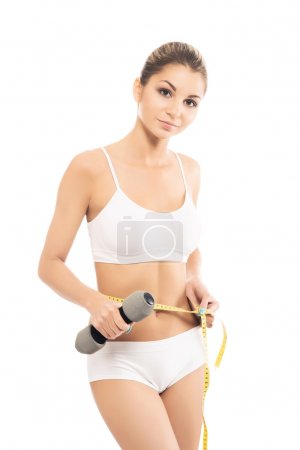 Girl with dumbbell and measuring