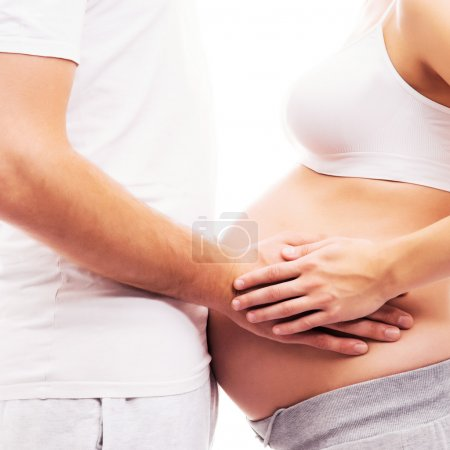 Body of a pregnant woman and a loving man
