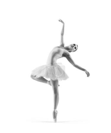 Photo pour Trace noire et blanche de jeune belle danseuse de ballet isolée sur fond blanc - image libre de droit