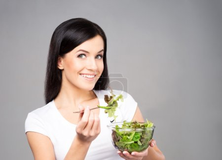 Young, beautiful and healthy teenage girl with a bowl of green