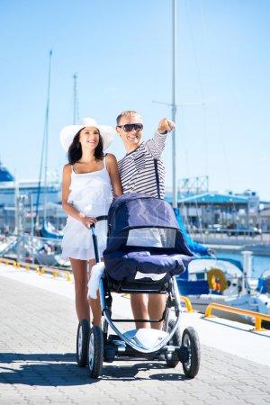 Couple walking with baby pram