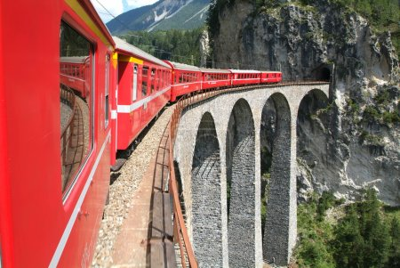 The train of Bernina Express on the Swiss alps