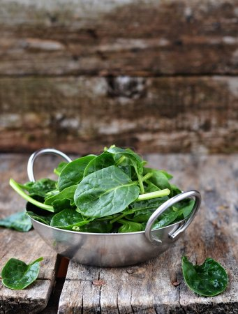 Photo for Frehs green spinach in to the bowl - Royalty Free Image