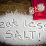 Eat less salt written on a heap of salt - antihype...