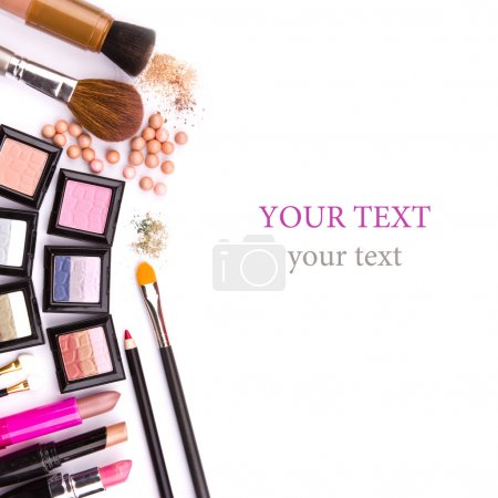 Makeup brush and cosmetics, on a white background ...